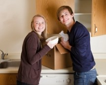 Couple packing kitchen equipment